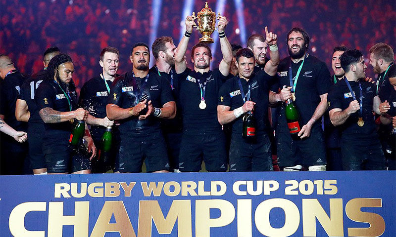 New Zealand holds the 2015 rugby world cup trophy